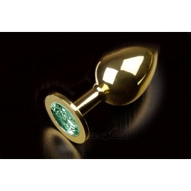 Большая золотая анальная пробка с закругленным кончиком и изумрудным кристаллом - 9 см.